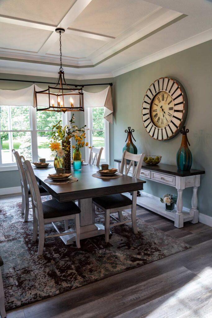 american farmhouse dining room with coretec plus xl james river oak vinyl flooring