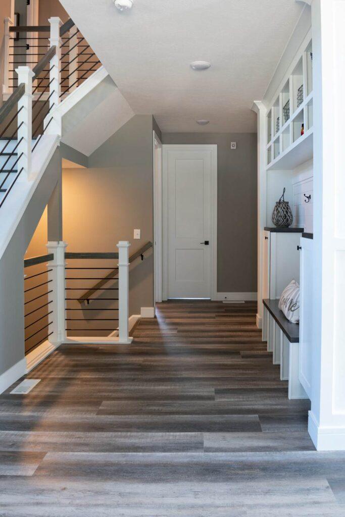american farmhouse hallway with coretec plus xl james river oak vinyl flooring
