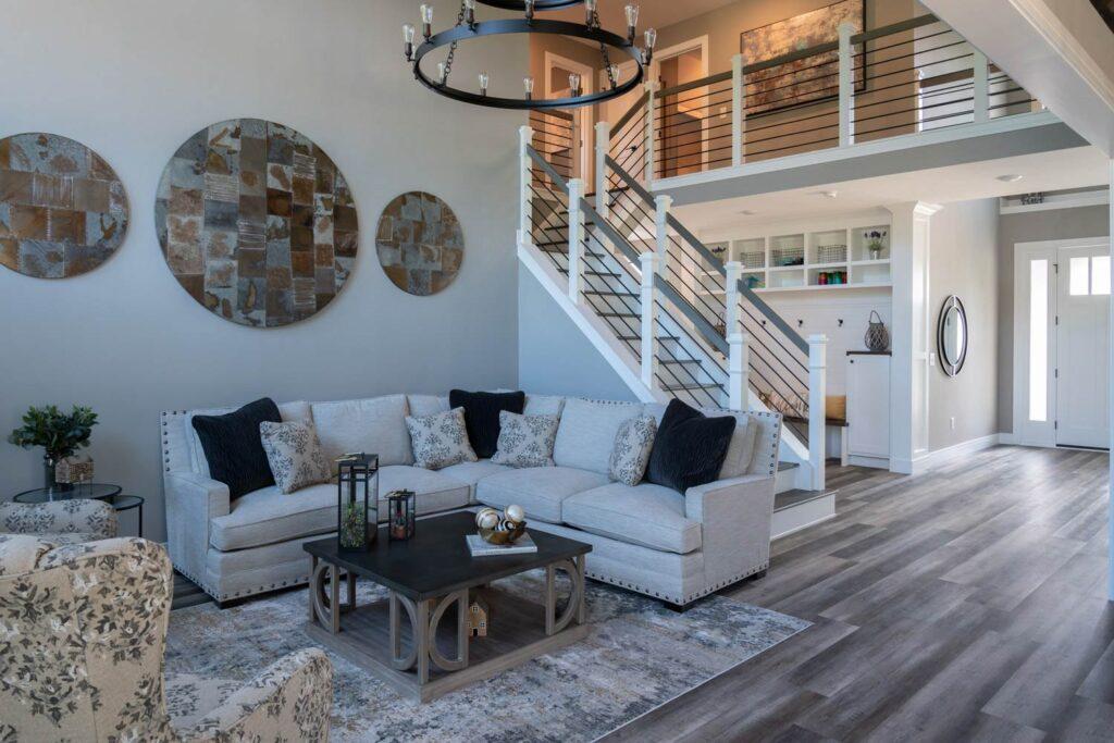 american farmhouse living room with coretec plus xl james river oak vinyl flooring