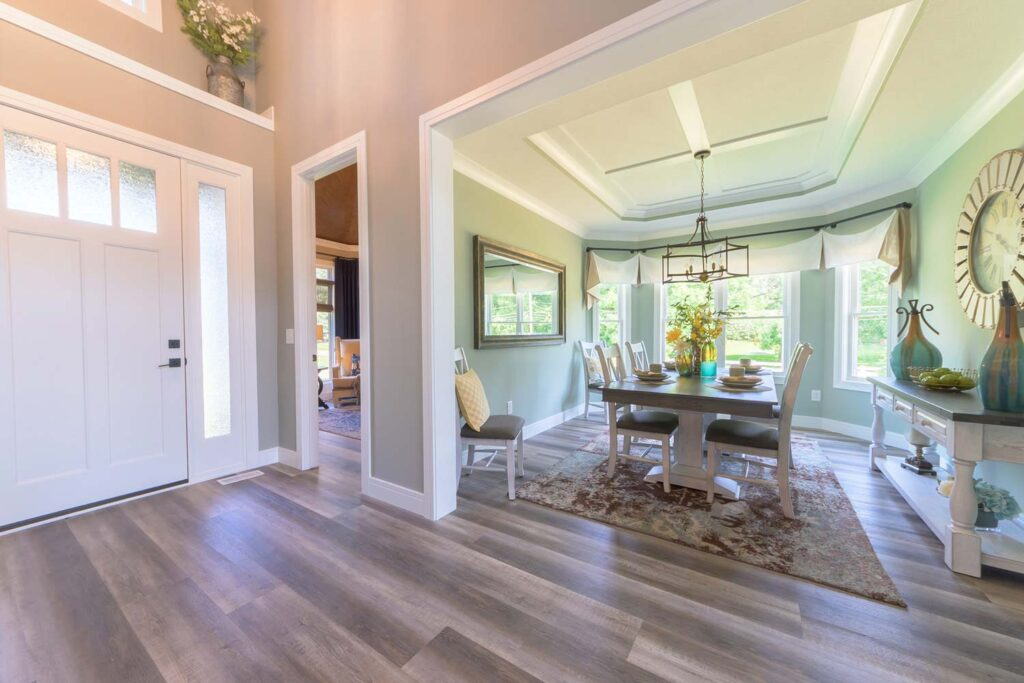 farmhouse dining room with coretec plus xl james river oak vinyl flooring