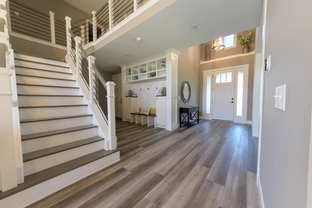 american farmhouse entry with coretec plus xl james river oak vinyl flooring