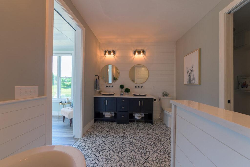 american farmhouse master bathroom with coretec plus xl james river oak vinyl flooring