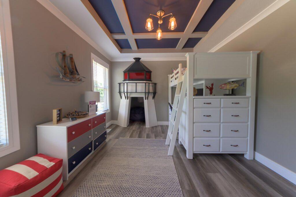 nautical boys bedroom with coretec plus xl james river oak vinyl flooring