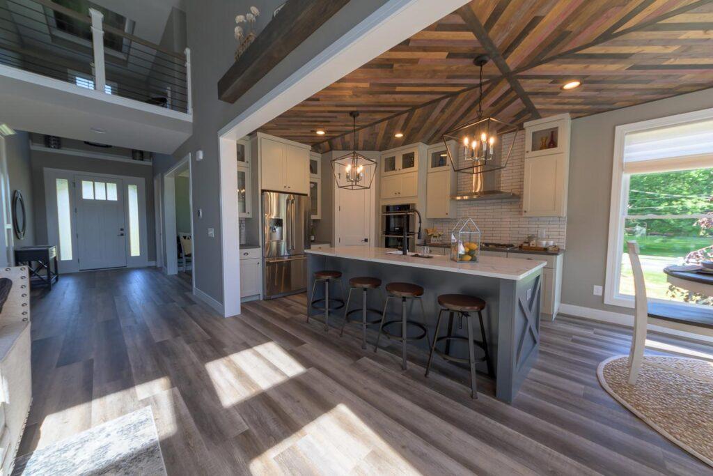american farmhouse kitchen with coretec plus xl james river oak vinyl flooring