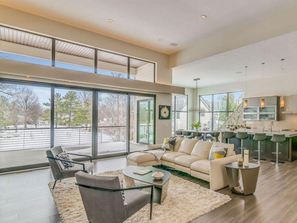 Modern custom home Living Room with Greige Laminate Flooring