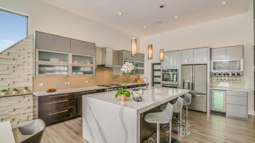 Modern Kitchen with Greige Laminate Flooring