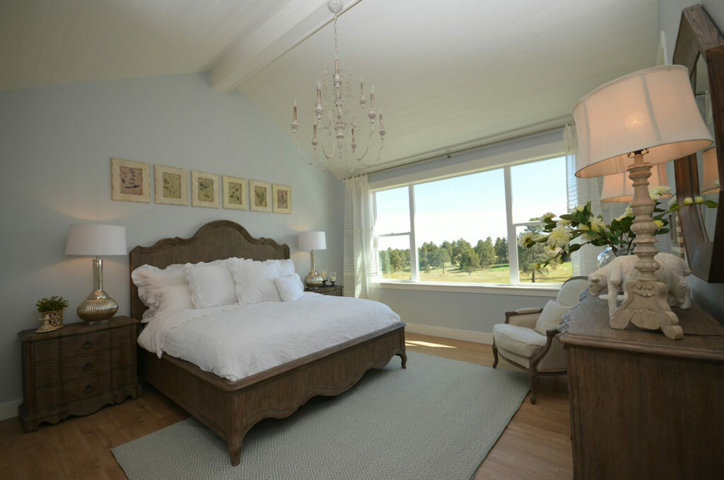 farmhouse master bedroom with quick step malted tawny oak laminate
